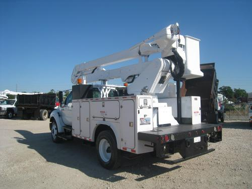 Material handler on bucket truck.